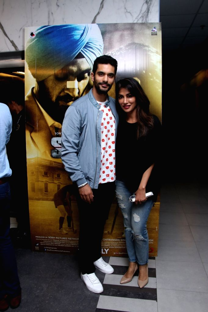 "Actors Angad Bedi and Chitrangada Singh at the special screening of upcoming film ""Soorma"" in Mumbai on July 11, 2018. - Angad Bedi and Chitrangada Singh"