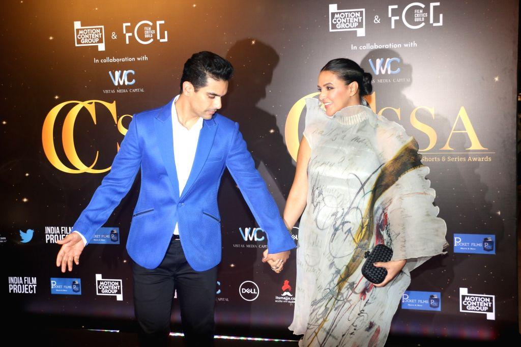 Actors Angad Bedi and Neha Dhupia at the red carpet of Critics' Choice Awards in Mumbai on Dec 11, 2019. - Angad Bedi and Neha Dhupia