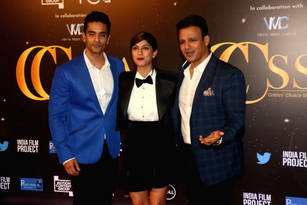 Actors Angad Bedi, Sapna Pabbi and Vivek Oberoi at the red carpet of Critics' Choice Awards in Mumbai on Dec 11, 2019. - Angad Bedi, Sapna Pabbi and Vivek Oberoi