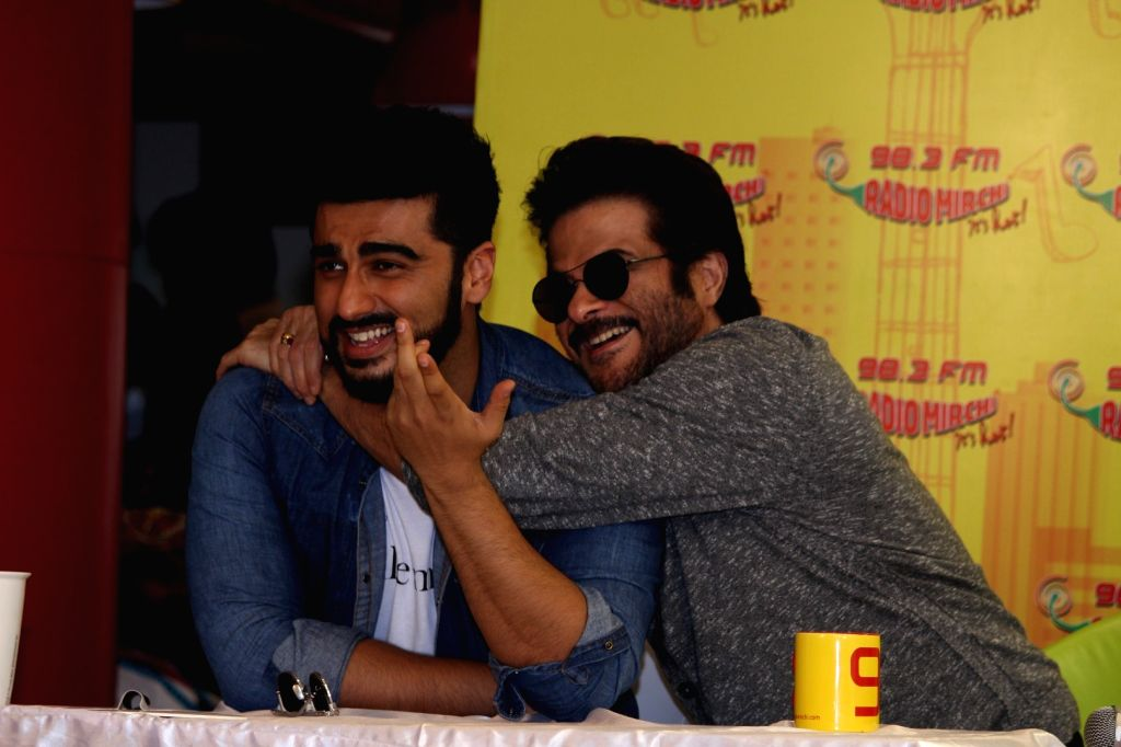 "Actors Anil Kapoor and Arjun Kapoor during the song launch ""Goggle Pake"" from their upcoming film ""Mubarakan"" at Radio Mirchi Studio in Mumbai on July 7, 2017. - Anil Kapoor and Arjun Kapoor"