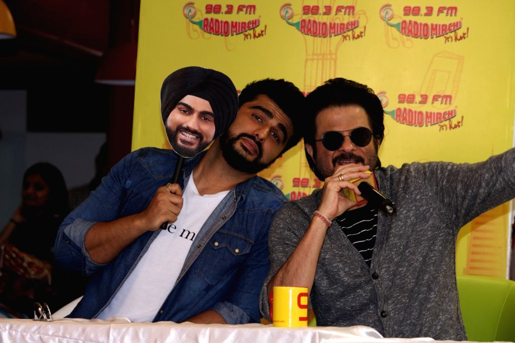 "Actors Anil Kapoor and Arjun Kapoor during the song launch ""Goggle Pake"" from their upcoming film ""Mubarakan"" at Radio Mirchi Studio in Mumbai on July 6, 2017. - Anil Kapoor and Arjun Kapoor"