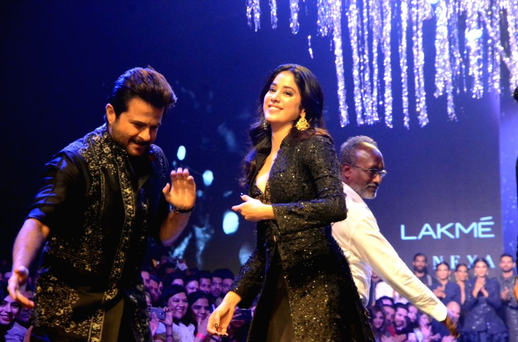 Actors Anil Kapoor and Janhvi Kapoor dressed up in fashion designer Raghavendra Rathore's creations, during the Lakme Fashion Week (LFW) Summer/Resort 2019 in Mumbai on Feb 2, 2019. - Anil Kapoor and Janhvi Kapoor