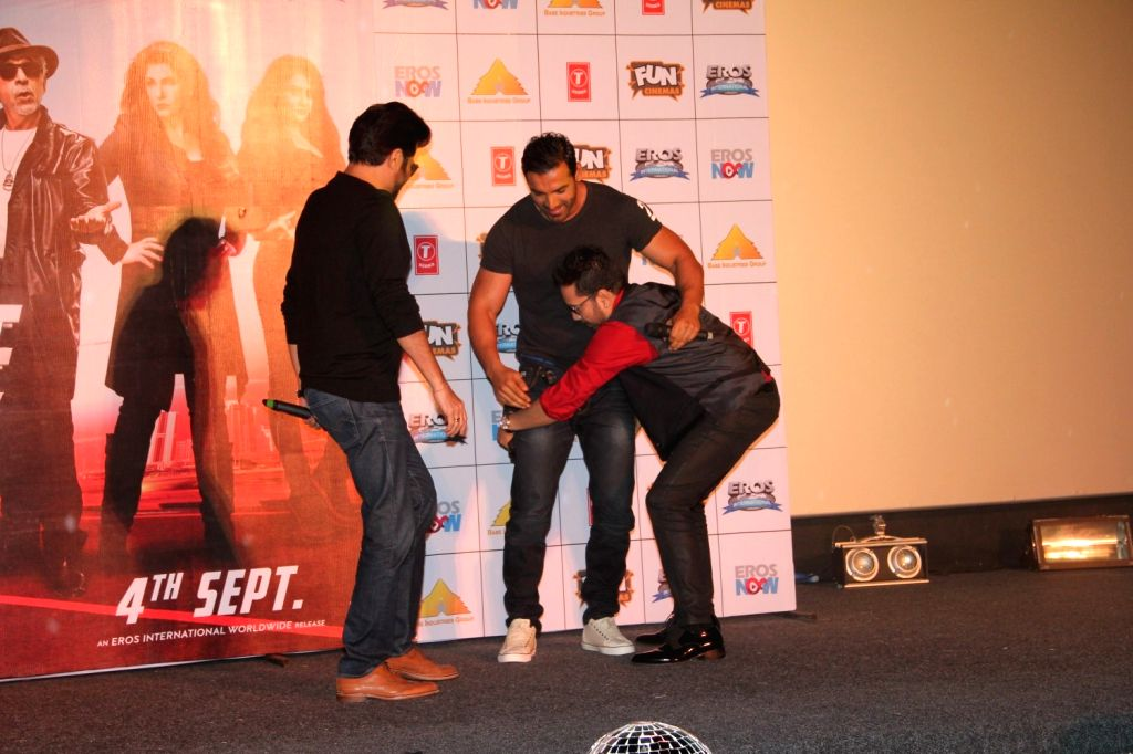 Actors Anil Kapoor and John Abraham with singer Mika Singh during the launch of title track song of film Welcome Back in Mumbai on Aug 8, 2015. - Anil Kapoor, John Abraham and Mika Singh