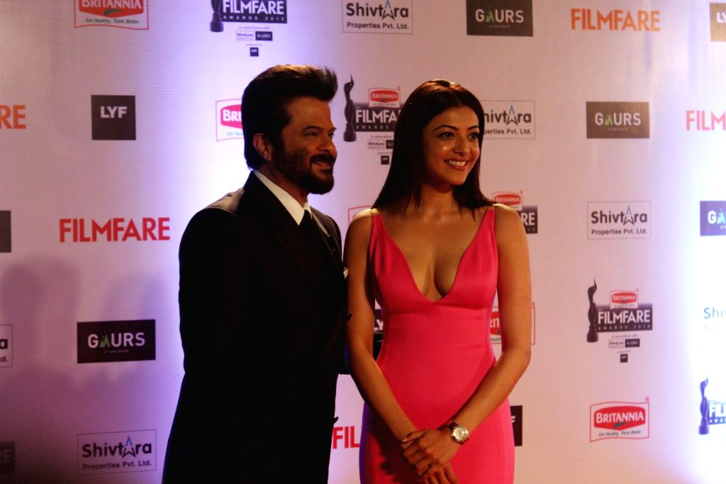 Actors Anil Kapoor and Kajal Aggarwal during the 61st Britannia Filmfare Awards in Mumbai on January 15, 2016. - Anil Kapoor and Kajal Aggarwal