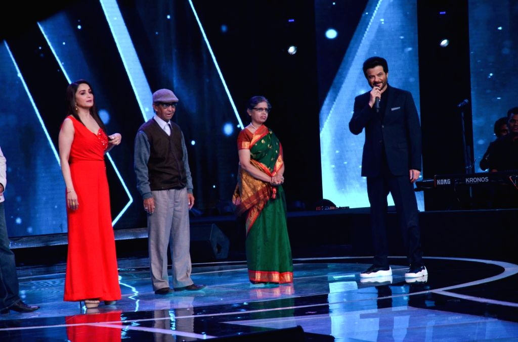 "Actors Anil Kapoor and Madhuri Dixit on the set of ""Sa Re Ga Ma Pa Lil Champs"" during the promotion of their upcoming film ""Total Dhamaal"" in Mumbai, on Feb 16, 2019. - Anil Kapoor and Madhuri Dixit"