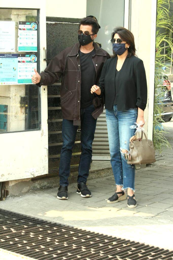 Actors Anil Kapoor and Neetu Kaoor seen at Chhatrapati Shivaji Maharaj International Airport in Mumbai on Nov 12, 2020. - Anil Kapoor and Neetu Kaoor