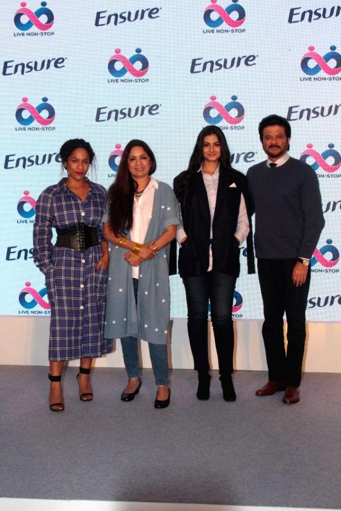Actors Anil Kapoor, Neena Gupta with producer Rhea Kapoor and Masaba Gupta during a programme in Mumbai on April 25, 2017. - Anil Kapoor, Neena Gupta and Masaba Gupta