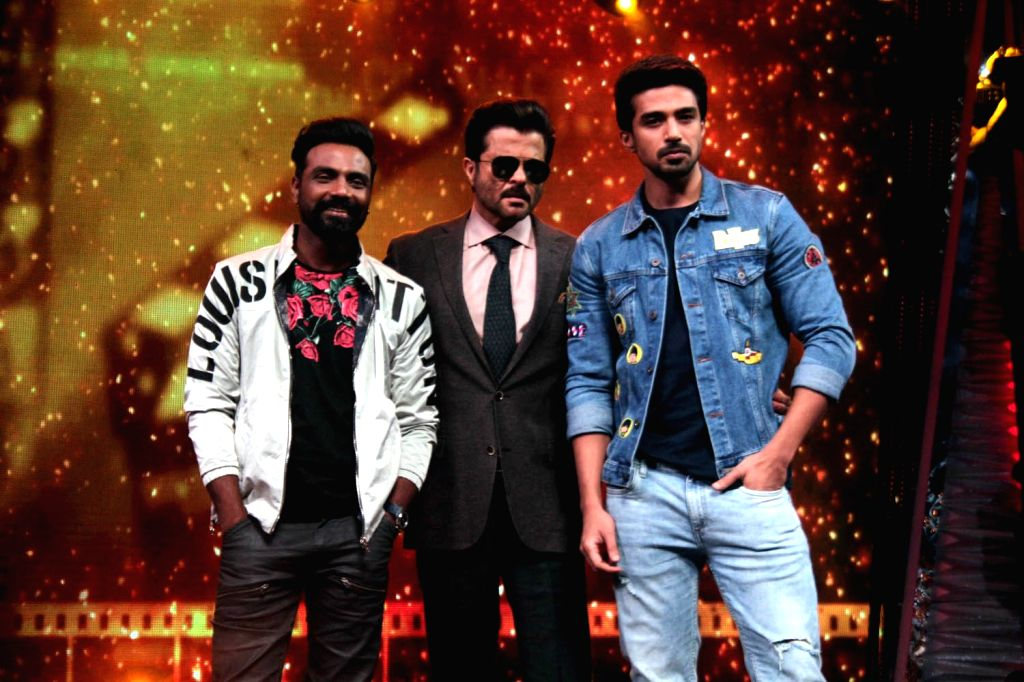 Actors Anil Kapoor, Saqib Saleem and director Remo D'Souza during the promotion of their upcoming film Race 3 on the sets of Dance India Dance Li'l Masters in Mumbai on June 4, 2018. - Remo D, Anil Kapoor and Saqib Saleem