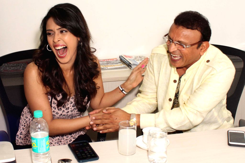 Actors Annu Kapoor and Hrishitaa Bhatt during an interaction at the office of IANS, in New Delhi, on June 22, 2015. - Annu Kapoor and Hrishitaa Bhatt