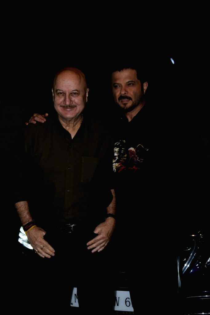 """Actors Anupam Kher and Anil Kapoor at the screening of upcoming film """"India's Most Wanted"""" in Mumbai, on May 20, 2019. - Anupam Kher and Anil Kapoor"""