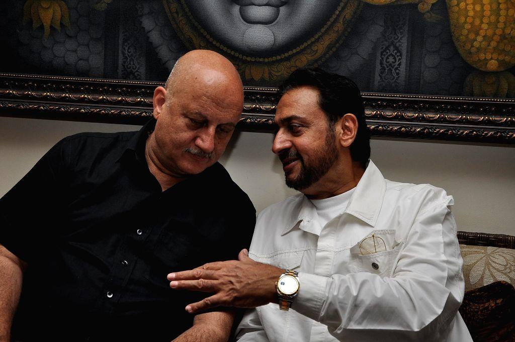 Actors Anupam Kher and  Gulshan Grover during a success party hosted by Sanjay Gupta to celebrate the success of writer Milap Zaveri's films 'Main Tera Hero', 'Grand Masti' and 'Shootout At Wadala' .. - Anupam Kher, Gulshan Grover and Sanjay Gupta