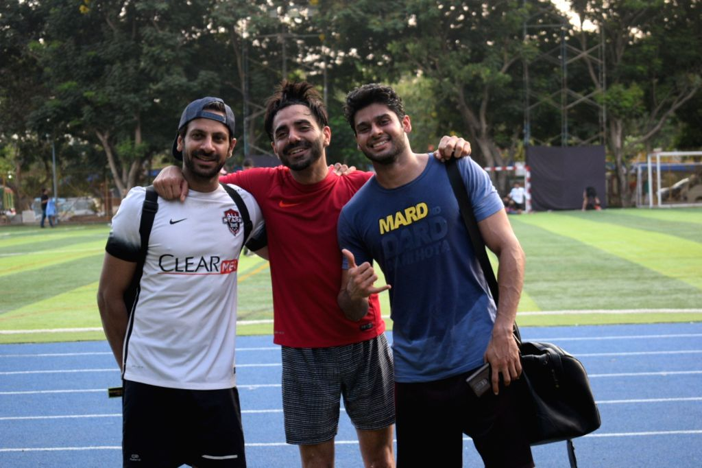 Actors Aparshakti Khurana, Abhimanyu Dasani and Karan Veer Mehra during a football match in Mumbai's Juhu, on April 14, 2019. - Aparshakti Khurana, Abhimanyu Dasani and Karan Veer Mehra