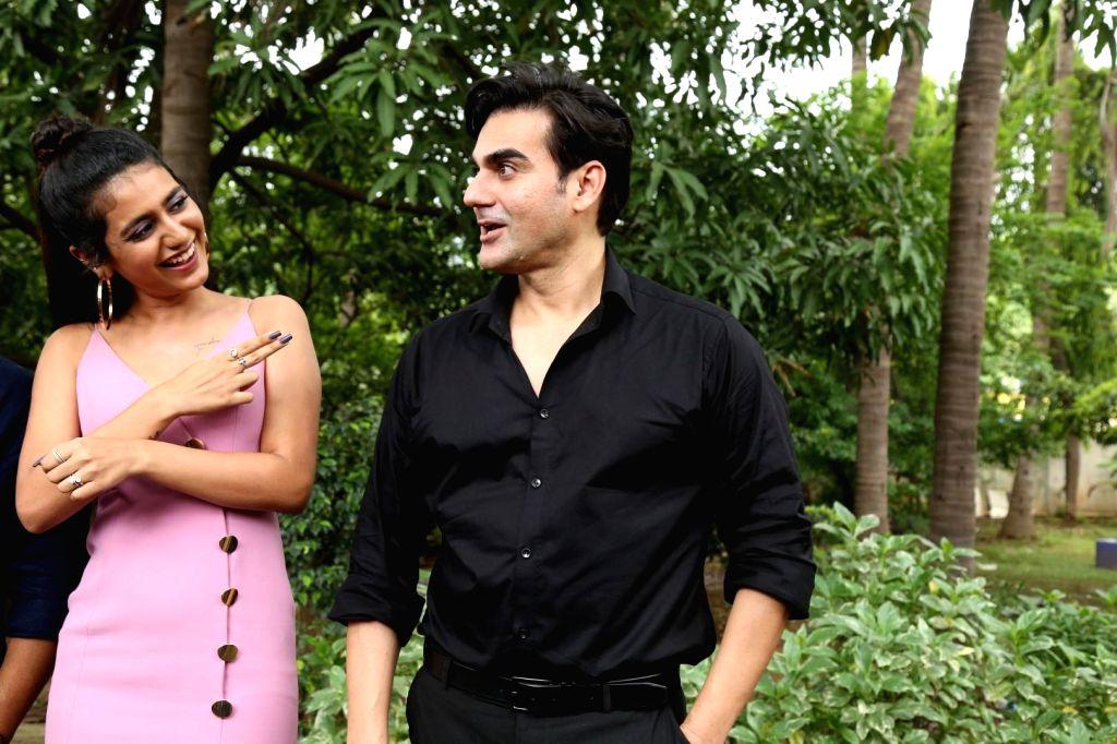 "Actors Arbaaz Khan and Priya Prakash Varrier during the shooting of their upcoming film ""Sridevi Bungalow"" in Mumbai on July 15, 2019. - Arbaaz Khan and Priya Prakash Varrier"
