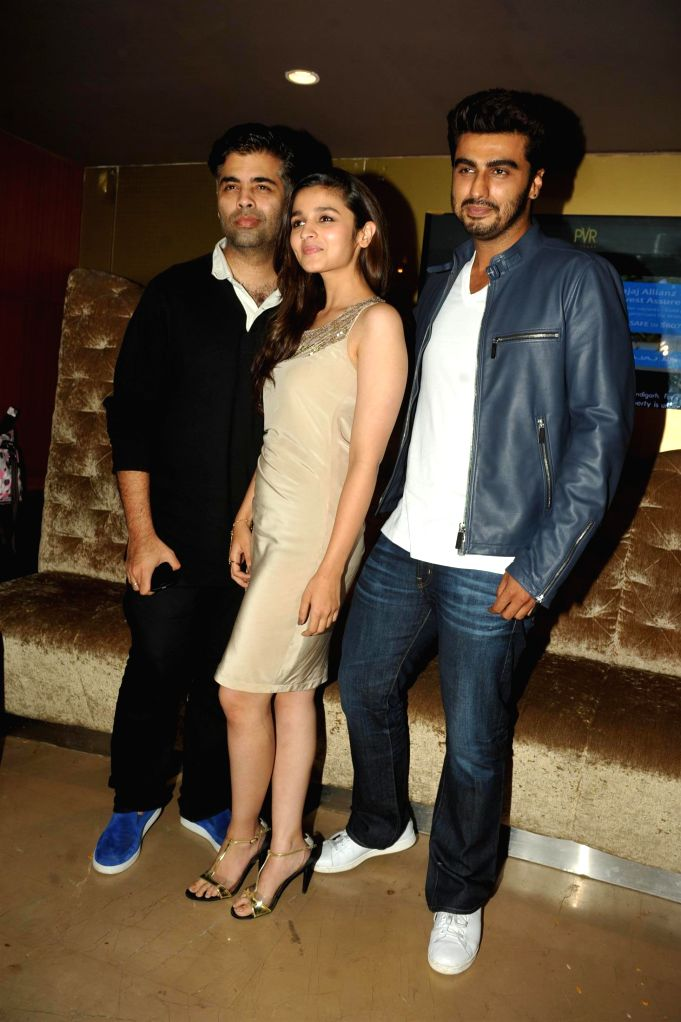 Actors Arjun Kapoor, Alia Bhatt and Karan Johar during the promotion of film 2 States at PVR Cinemas in Mumbai on April 18, 2014. - Arjun Kapoor, Alia Bhatt and Karan Johar