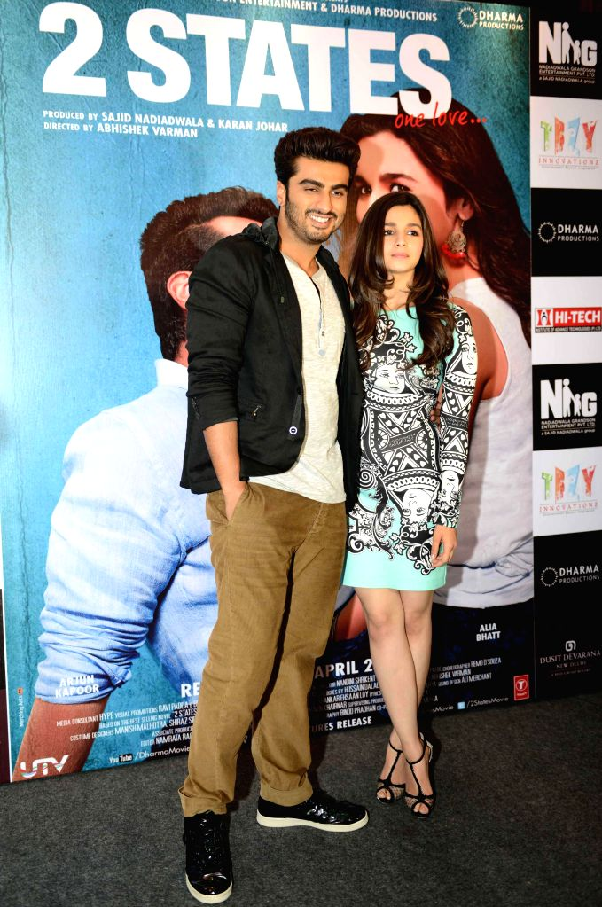 Actors Arjun Kapoor and Alia Bhatt during a press conference to promote their upcoming film '2 States' in New Delhi on April 16, 2014. - Arjun Kapoor and Alia Bhatt