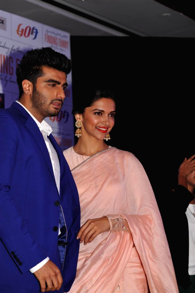 Actors Arjun Kapoor and Deepika Padukone during the film Finding Fanny and Goa Tourism tie up event in Mumbai on 10 Sept, 2014.