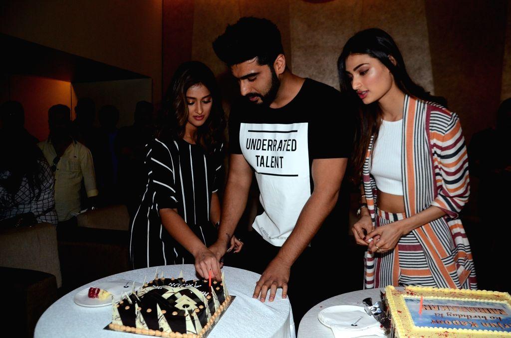 Actors Arjun Kapoor and Ileana D'Cruz  during Kapoor's birthday celebration in Mumbai, on June 25, 2017.Arjun Kapoor's birthday is on 26th June. - Arjun Kapoor and Ileana D'Cruz
