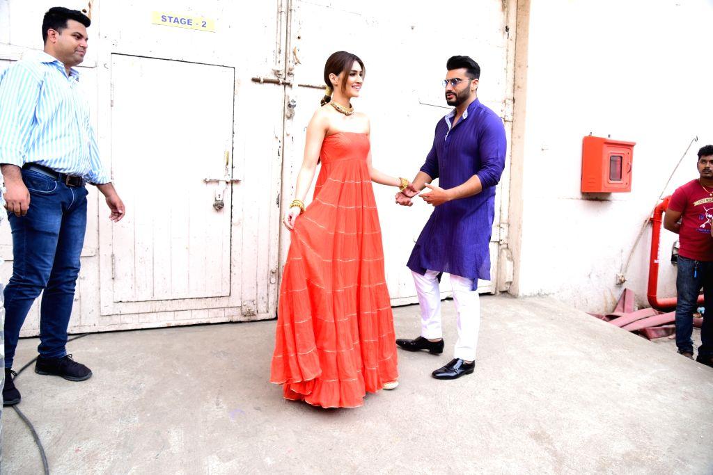 "Actors Arjun Kapoor and Kriti Sanon at the promotions of upcoming film ""Panipat"" in Mumbai on Dec 3, 2019. - Arjun Kapoor and Kriti Sanon"