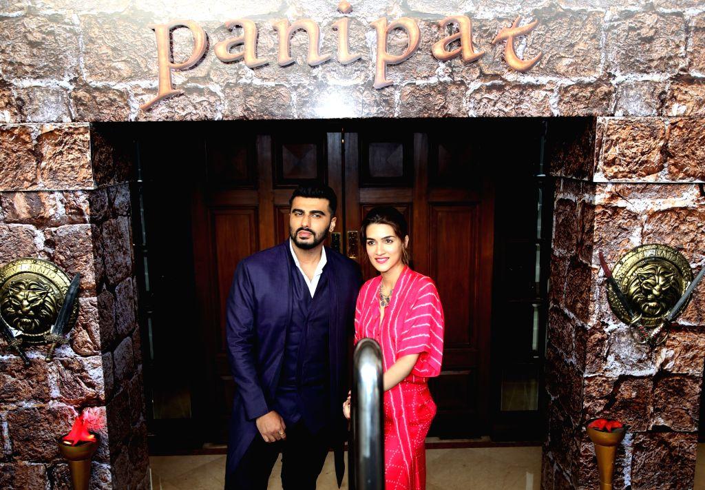 "Actors Arjun Kapoor and Kriti Sanon during a press conference organised to promote upcoming film ""Panipat"" in New Delhi on Nov 29, 2019. - Arjun Kapoor and Kriti Sanon"