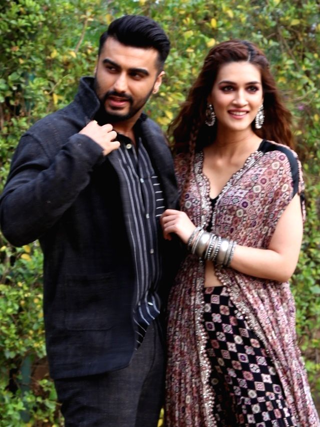 """Actors Arjun Kapoor and Kriti Sanon during the promotion of their upcoming film """"Panipat"""" in New Delhi on Nov 28, 2019. - Arjun Kapoor and Kriti Sanon"""