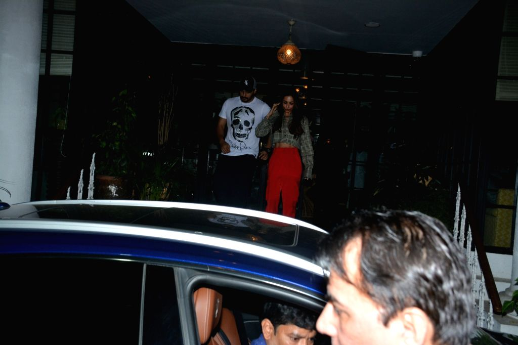 Actors Arjun Kapoor and Malaika Arora seen at a club in Mumbai's Juhu, on Feb 6, 2019. - Arjun Kapoor and Malaika Arora