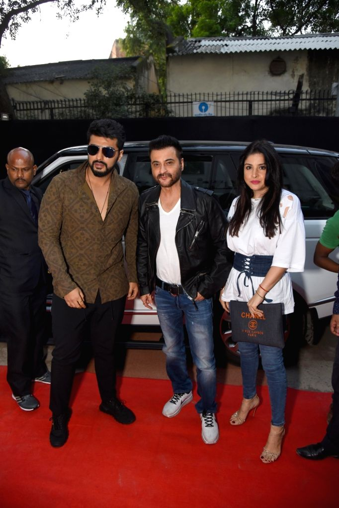 Actors Arjun Kapoor and Sanjay Kapoor at the launch of a fitness center in New Delhi on Sept 26, 2017. - Arjun Kapoor and Sanjay Kapoor