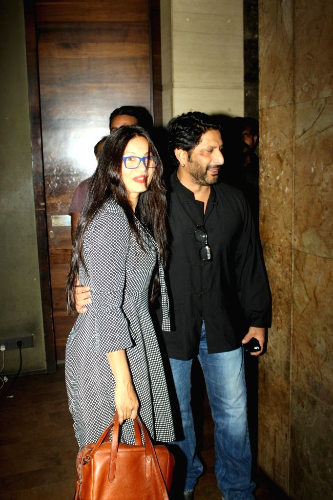 Actors Arshad Warsi and Maria Goretti during the screening of film Kapoor and Sons in Mumbai, on March 17, 2016. - Arshad Warsi and Maria Goretti