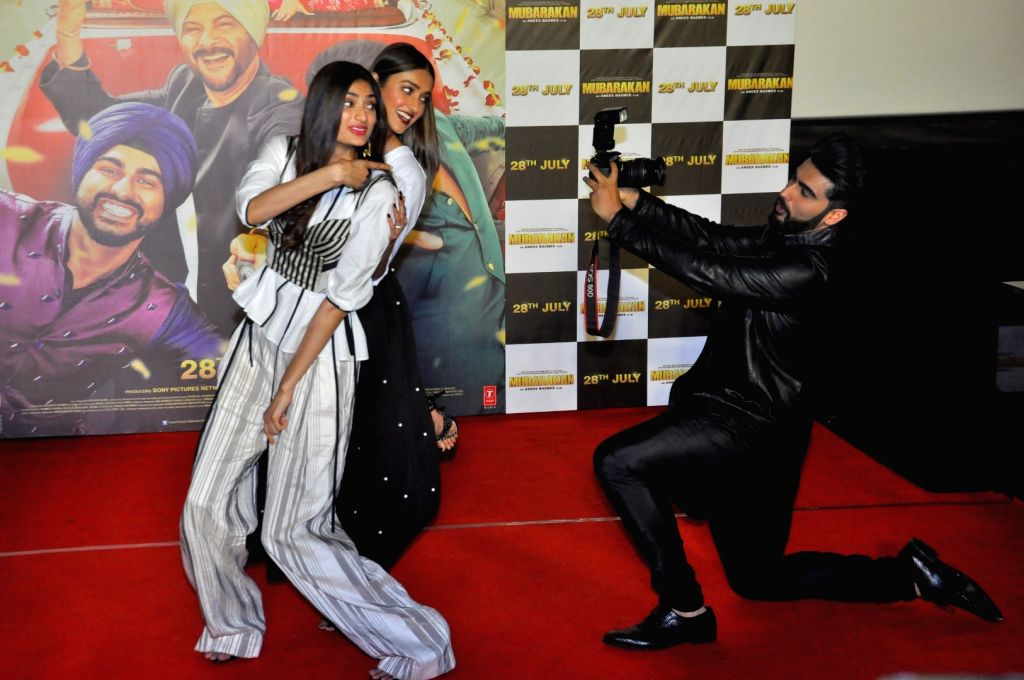 Actors Athiya Shetty, Arjun Kapoor and Ileana D'cruz at the trailer launch of upcoming film 'Mubarakan' in Mumbai on June 20, 2017. - Athiya Shetty, Arjun Kapoor and Ileana D