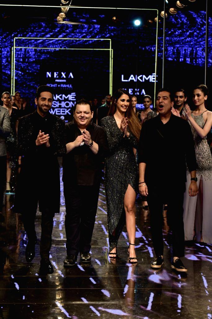 Actors Ayushmann Khurrana and Disha Patani with designers Rohit Gandhi and Rahul Khanna at the Lakme Fashion Week Winter/Festive 2019 in Mumbai on Aug 24, 2019. - Ayushmann Khurrana, Disha Patani, Rohit Gandhi and Rahul Khanna