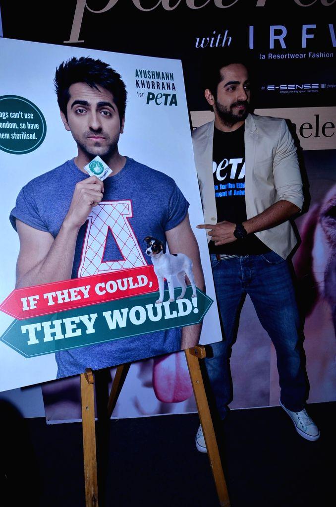 Actors Ayushmann Khurrana endorses PETA campaign for dogs in Mumbai on December 13, 2013. - Ayushmann Khurrana