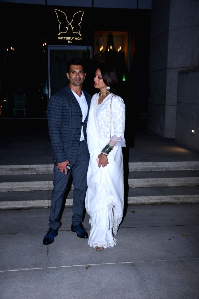 Actors Bipasha Basu and Karan Singh Grover seen at Bandra Kurla Complex in Mumbai on Oct 17, 2019. - Bipasha Basu and Karan Singh Grover