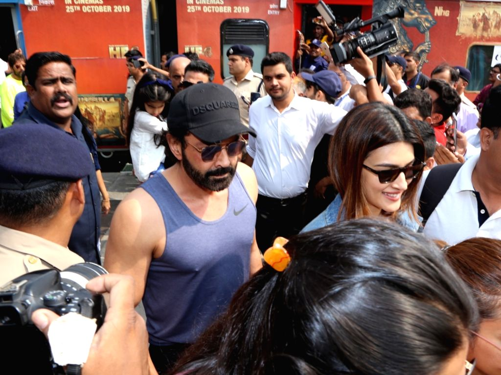 Actors Bobby Deol and Kriti Sanon after reaching the New Delhi Railway Station, on Oct 17, 2019. On October 16, the team of the upcoming comedy 'Housefull 4' became the first Bollywood ... - Bobby Deol and Kriti Sanon