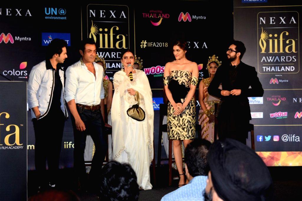 Actors Bobby Deol, Varun Dhawan, Rekha, Kriti Sanon and Ayushmann Khurrana during a press conference of the 19thEdition of IIFA in Mumbai on June 12, 2018. - Bobby Deol, Varun Dhawan, Rekha, Kriti Sanon and Ayushmann Khurrana
