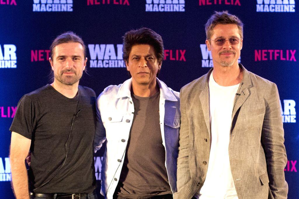Actors Brad Pitt and Shah Rukh Khan during a programme in Mumbai on May 24, 2017. - Brad Pitt and Shah Rukh Khan