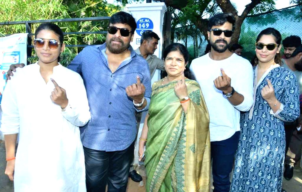Actors Chiranjeevi and Allu Arjun show their inked fingers after casting their votes for the 2019 Lok Sabha elections in Hyderabad, on April 11, 2019. - Chiranjeevi and Allu Arjun