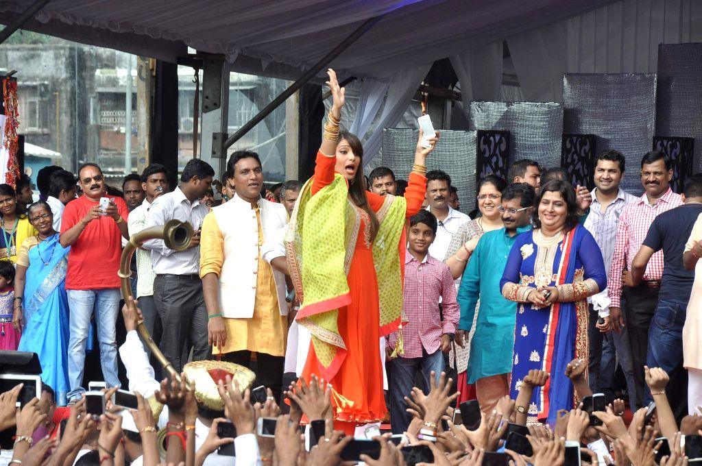 Actors Chunky Pandey and Bipasha Basu during Dahi Handi 2014 celebrations organised by MNS leader Ram Kadam at Ghatkopar in Mumbai on Aug. 18, 2014. - Chunky Pandey and Bipasha Basu