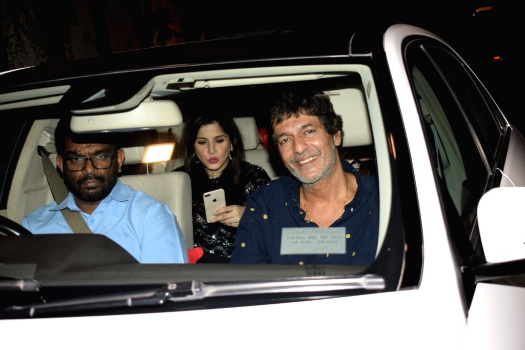 Actors Chunky Pandey and Maheep Sandhu arrive to attend designers Abu Jani and Sandeep Khosla's party in Mumbai on Dec 9, 2017. - Chunky Pandey and Maheep Sandhu