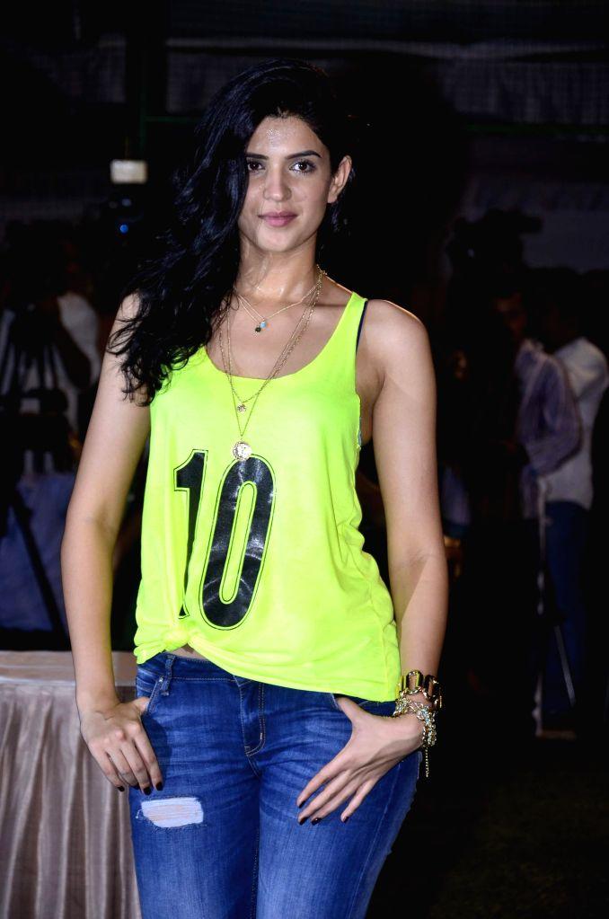 Actors Deeksha Seth .during the football match organised to promote the upcoming film Lekar Hum Deewana Dil in Mumbai on June 17th, 2014. - Deeksha Seth