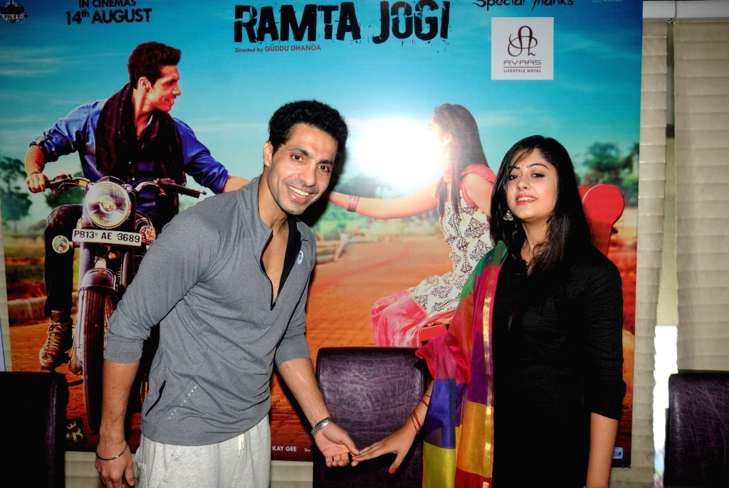 Actors Deep Sidhu and Ronica Singh during the promotion of their upcoming Punjabi film `Ramta Jogi` in Amritsar on Aug 9, 2015. - Deep Sidhu and Ronica Singh