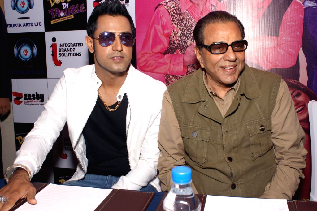 Actors Dharmendra and Gippy Grewal during a press conference to promote their upcoming film 'Double Di Trouble` in New Delhi on Aug 20, 2014. - Dharmendra and Gippy Grewal