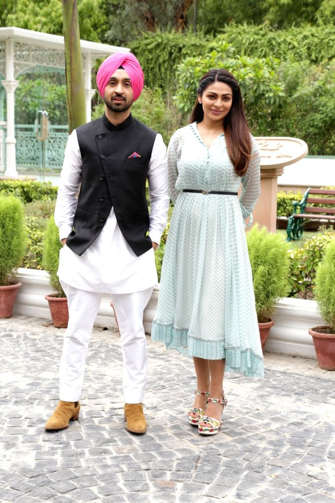 "Actors Diljit Dosanjh and Neeru Bajwa during the promotion of their upcoming film ""Shadaa"", in New Delhi on June 18, 2019. - Diljit Dosanjh and Neeru Bajwa"