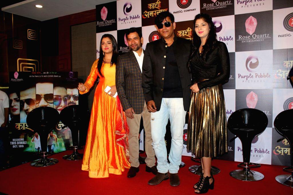 "Actors Dinesh Lal Yadav, Ravi Kishan, Sapna Gil and Amrapali Dubey during the trailer launch of film ""Kaashi Amarnat"" in Mumbai on Sept 16, 2017. - Dinesh Lal Yadav, Ravi Kishan, Sapna Gil and Amrapali Dubey"
