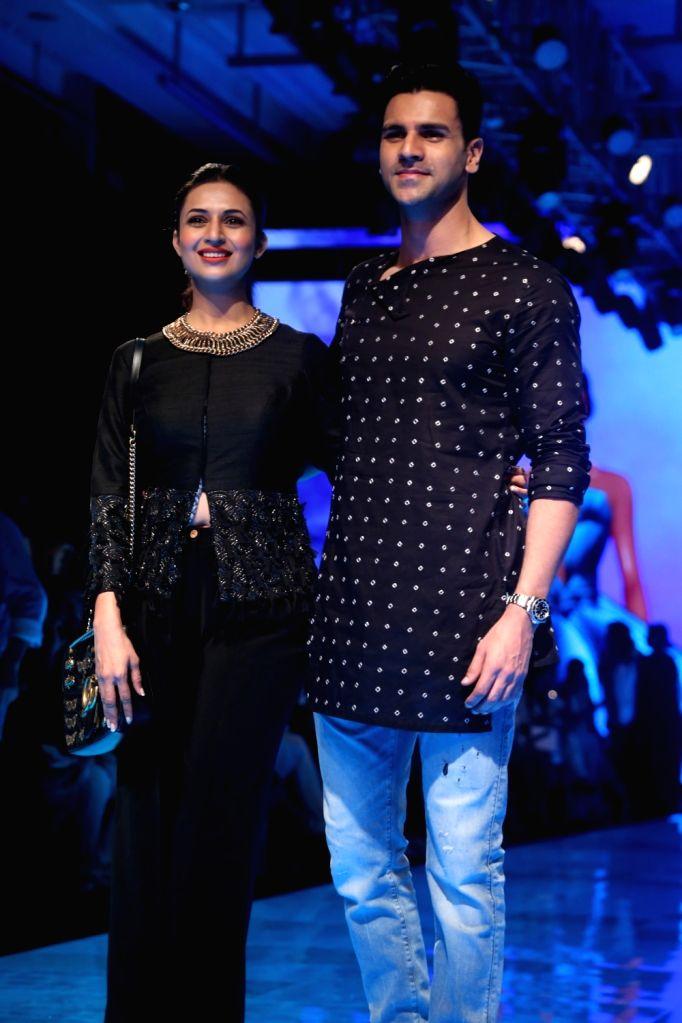 Actors Divyanka Tripathi and Vivek Dahiya at the Lakme Fashion Week Winter/Festive 2019 in Mumbai on Aug 25, 2019. - Divyanka Tripathi and Vivek Dahiya