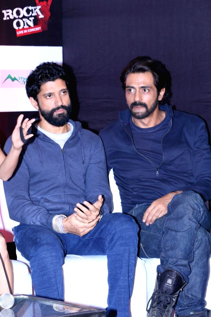 Actors Farhan Akhtar and Arjun Rampal during the music launch of the movie Rock On 2 in Mumbai on Sept. 17, 2016. - Farhan Akhtar and Arjun Rampal