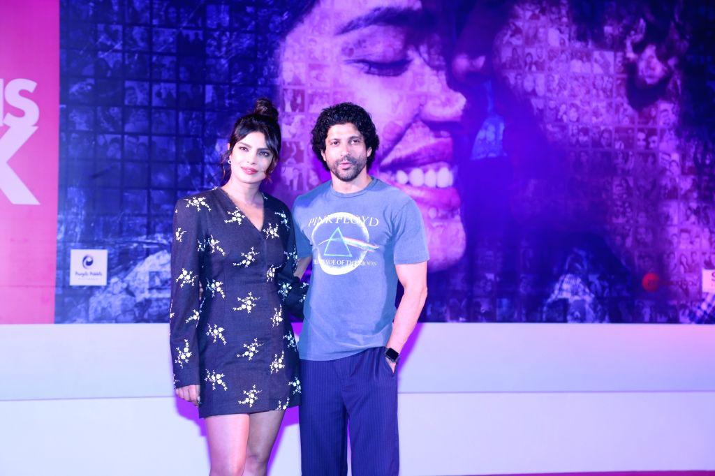 "Actors Farhan Akhtar and Priyanka Chopra during the promotions of their upcoming film ""The Sky Is Pink"" in Mumbai on Oct 6, 2019. - Farhan Akhtar and Priyanka Chopra"