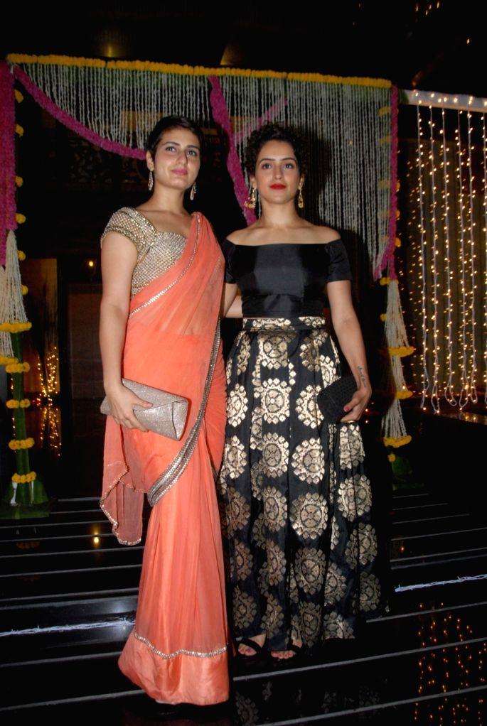 Actors Fatima Sana Shaikh and Sanya Malhotra during Aamir Khan's Diwali celebration in Mumbai, on Oct 30, 2016. - Fatima Sana Shaikh, Sanya Malhotra and Aamir Khan