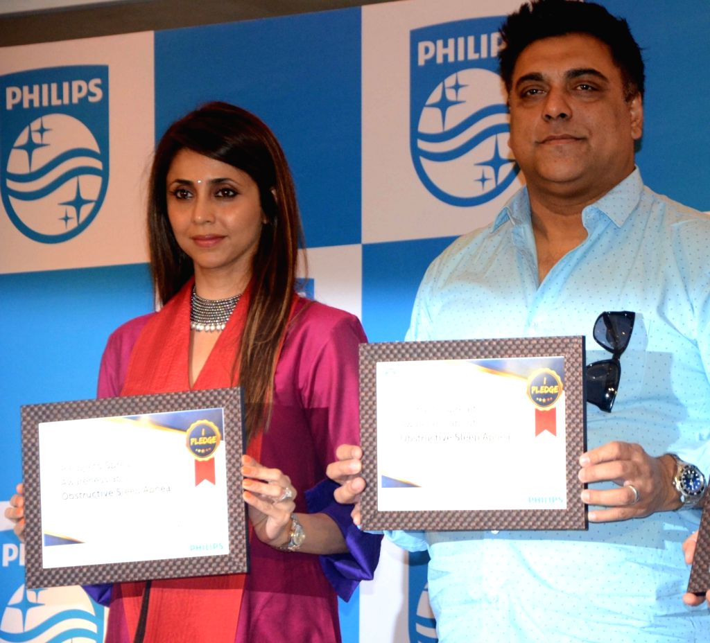 Actors Gautami Kapoor and Ram Kapoor during a Philips press conference in Mumbai, on May 3, 2017. - Gautami Kapoor and Ram Kapoor