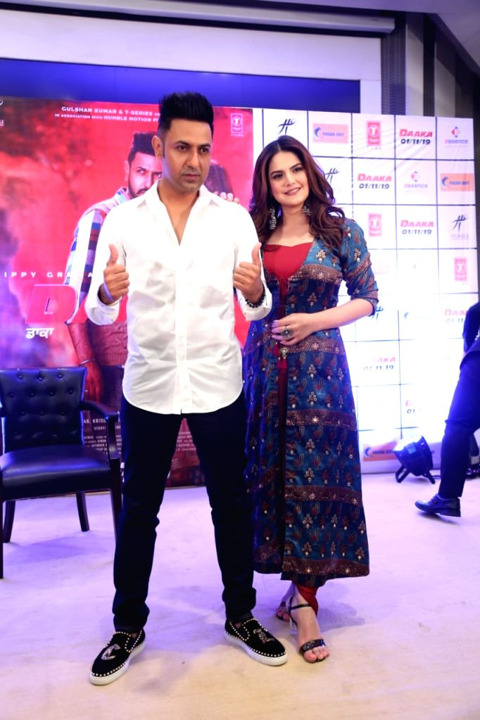 """Actors Gippy Grewal and Zareen Khan during the promotions of her upcoming film """"Daaka"""" in New Delhi on Oct 24, 2019. - Gippy Grewal and Zareen Khan"""