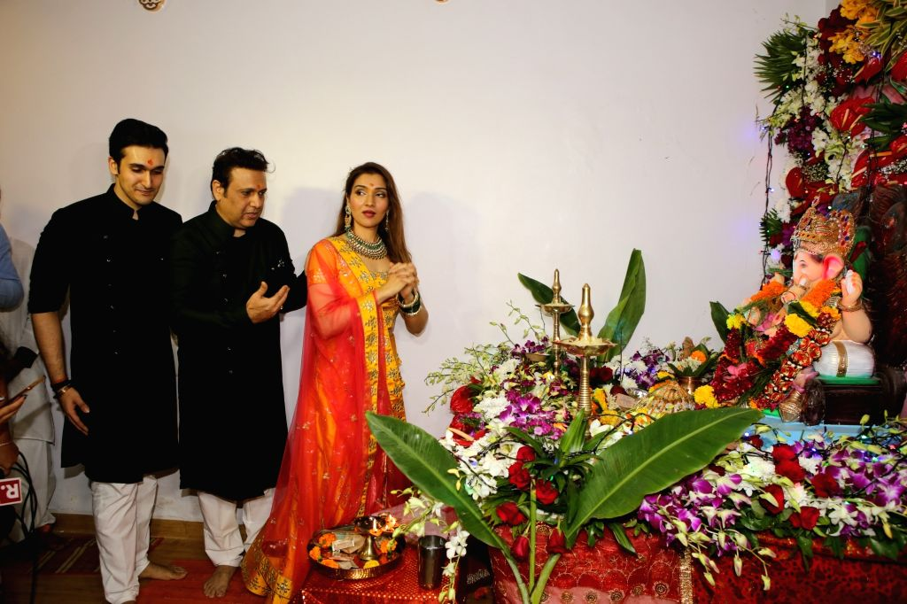 Actors Govinda and his children Tina Ahuja and Yashvardan Ahuja offer prayers to Lord Ganesha at their residence during Ganesh Chaturthi celebrations, in Mumbai on Sep 2, 2019. - Govinda