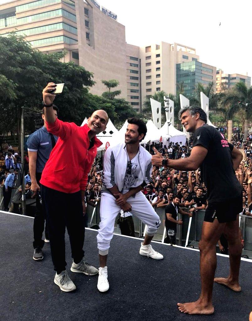 Actors Hrithik Roshan and Milind Soman with Xiaomi India Managing Director Manu Jain during a marathon in Bengaluru, on March 31, 2018. - Hrithik Roshan, Milind Soman and Manu Jain